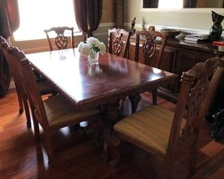 Dining room table with six chairs. $500.00 AS IS...there is some discoloration on the table and the seat covers need to be changed. Dimensions: 31 tall x 75 long x 43 wide