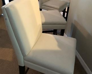 Four White barstools $150.00 all AS IS.  Please see pictures for AS IS description.  Dimension:  39 high, 19 wide, 19 deep.  Seat height 24 inches
