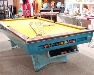 Comes with Cue Sticks, Rack, Vintage Balls and original Cover. The owners have purchased matched paint for the legs and comes with the table.