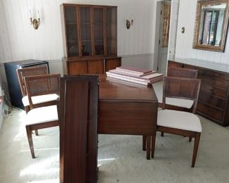 Drexel Drop Leaf Table with 4 Chairs. There are 3 large and 1 small leaves. Table pads are in fair condition.
