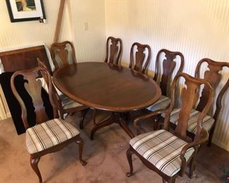 """Thomasville Cherry table with 1.5"""" inlaid rim, eight (8) upholstered chairs, two (s) leaves 24"""" wide making the table extend up to ten(10) feet."""