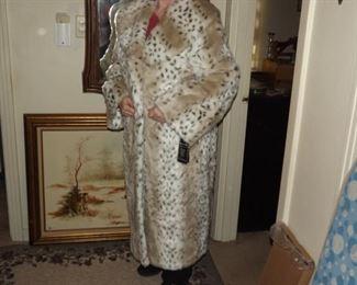 Beautiful faux fur long coat. Still has tags.  $150.00