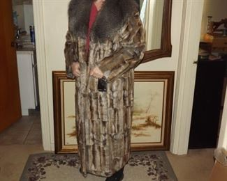 Full lenght coat with collar. Tags still on it.  $150.00