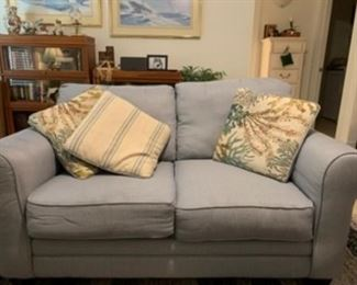 "6.  Light blue loveseat with (3) coral design pillows  63""Lx 36""D                    $120"