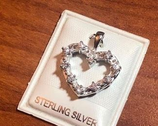 $8 Heart shaped sterling silver point pendant with glass Or Crystal stones