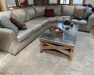 Very nice super comfortable greay leather sectional in new condition