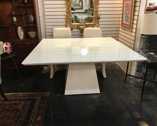 Artefacto Dining Table Originally $5,000 Sale price $1750. Glass top white glossy enameled wood.