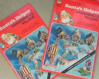 Santa's Helper Ginger bread Village one village is in new condition one village has been used