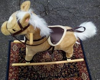 Rocking horse, great shape, neighs and tail wags $22