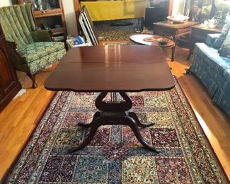 """I'm still very impaired, wine-wise, this looks like a harp table and oriental rug (even though """"oriental"""" is unwoke according to my teenage daughter"""