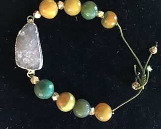 Crystal stone with hand cut beads. $20