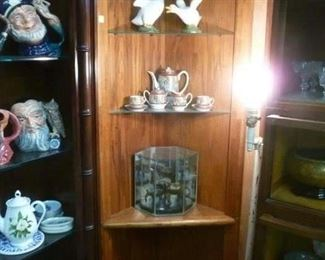 Corner cabinet with top light, 2 glass shelves over one fixed wood shelf @ $30