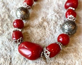 Costume jewlery. Red and silver beaded necklace. Some tarnish visible on silver. $10