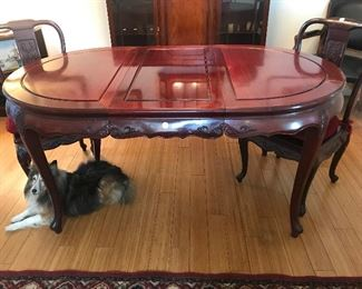 "$1,200 -- Carved Rosewood dining table with single leaf.  H 31""xW 39"",L 67"" (including leaf).  $200 Pair of chairs are separate"