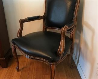$125 -- Black leather side chair.