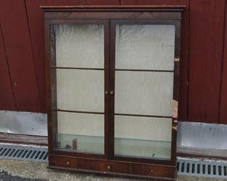 Mahoghany veneer glass door display cabinet with 3 glass shelves. Some missing veneer (pieces inside). $38