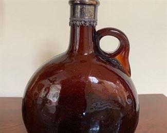 179. Amber Glass Bottle w/ Silver Top,  $150.00