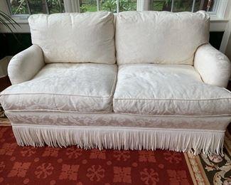 57. Upholstered Cream 2 Cushion Loveseat w/ Bouillon Fringe (37'' x 37'' x 34''),  $ 1,200.00