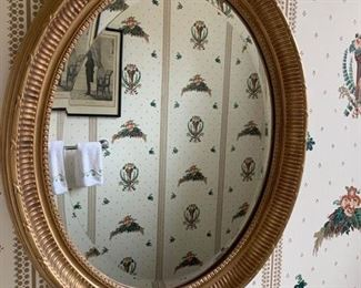 66. Oval Bevelled Gilt Carved Mirror (19'' x 23''),   $ 180.00