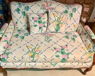 193. Wood Framed Settee w/ Floral Upholstery,  $ 350.00