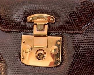 Gucci Brown Skin Handbag w/ Brass Detail (very good condition) (8'' x 7'') $400
