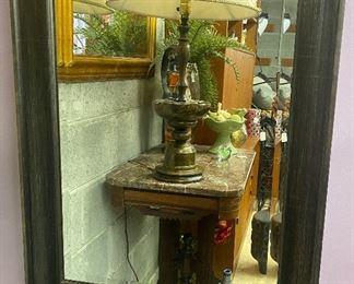 "$35. Black trimmed wood mirror. 23""W x 29""H."