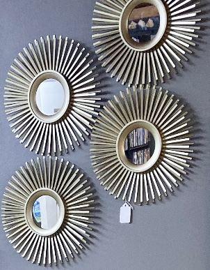 "$32 for the set of 4. Gold Midcentury Modern plastic sunburst mirrors. 10""W"