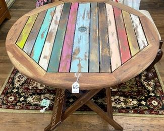 """$65. Outdoor multicolored wooden patio table. 29""""W x 30""""H"""