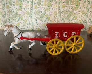 cast iron horse and wagon. 25.00