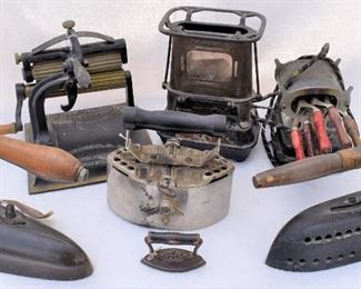 Antique irons, fluters, curling irons, and iron heaters.