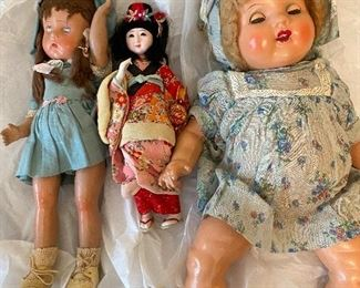 Two antique dolls, Asian inspired doll with stand