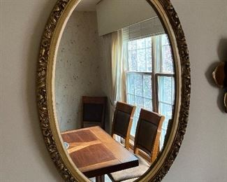 Gilt gold oval wall mirror