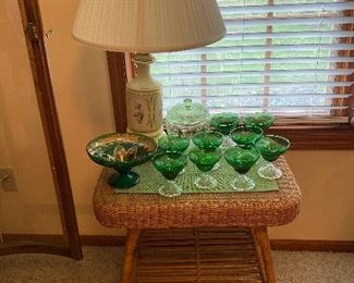 Wicker end table, green glass, table lamp