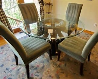 """$300 - Glass top table & 4 chairs (pretty shade of a lighter green color) Table is 54"""" in diameter and 29 1/2"""" tall."""