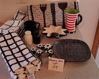 $15 - Misc. black & white kitchen items, including 5 kitchen towels and one washcloth