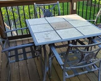 """$75 - Aluminum & tile top patio table & 4 chairs Table is 39"""" x 39"""" x 28""""tall"""