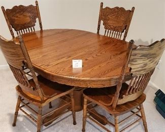 $100 - Dining table & 4 chairs (one leaf included as shown in picture)