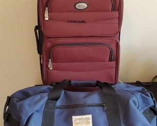 """$16 - Maroon luggage is 16"""" x 24"""" and Blue duffel bag is 24"""" across"""