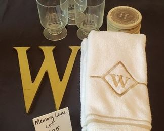 """$12 - """"W"""" Lot - The large 'W' wall hanging is brass. Hand towels are made by Santens (like new). Coasters are sandstone."""