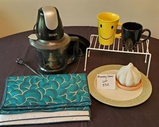 $22 - Misc. Kitchen items including the Ninja Storm food processor and 4 place mats