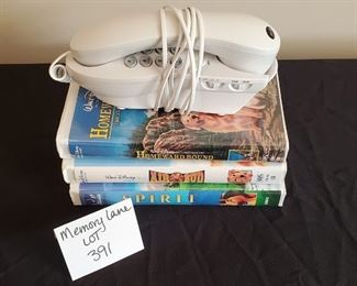 $5 - 3 VHS movies & a phone