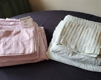$11 - 2 queen sheet sets. Pink one is a 4 pc. DKNY & mint green one is a 3 pc (only one pillowcase) Devatex set.