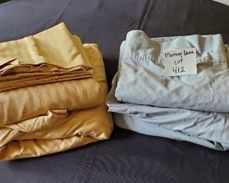 $13 - 2 Queen sheet sets. The brown set is a 6 pc set and the gray set is a 4 pc set. (gray pillowcases are not pictured but are included)