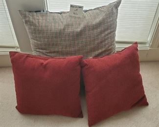 """$12 - 3 pillows. The largest one is reversible with plaid pattern on other side and 23""""."""