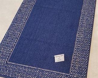 """$25 - Blue 52"""" x 30"""" rug"""