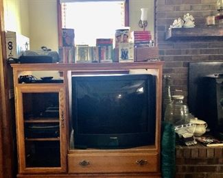 TV cabinet, Panasonic TV, VHS's, DVD's, outdoor antenna, VHS player and DVD player