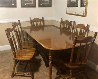 Large dining table with 6 matching chairs, gold framed mirror and framed art