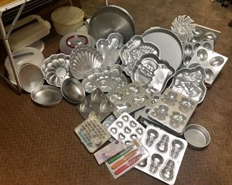 Large collection of Wilton cake pans