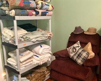 La-Z-Boy recliner, hats, vintage quilts and sheets
