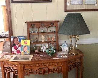 Marble top carved table, Sears catalog, lamp, John Kollock prints, small wood shelf with miniatures